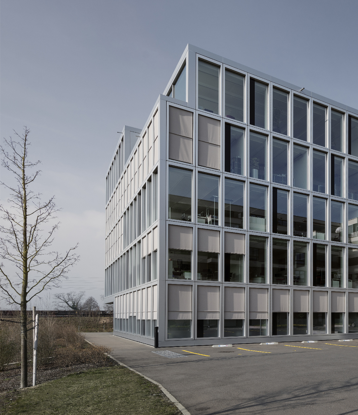 office building facade. On An Iconic Level, The «Kirk Hus» Recalls Bifurcated, Subversive Messages Rem Koolhaas\u0027 Buildings Seem To Speak: One Hand, Glassy Facade Office Building A