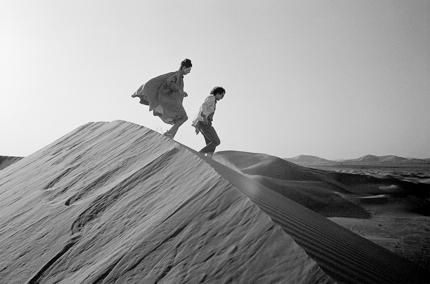 Christo and Jeanne-Claude looking for a possible site for The Mastaba, February 1982, Photo: Wolfgang Volz © 1982 Christo