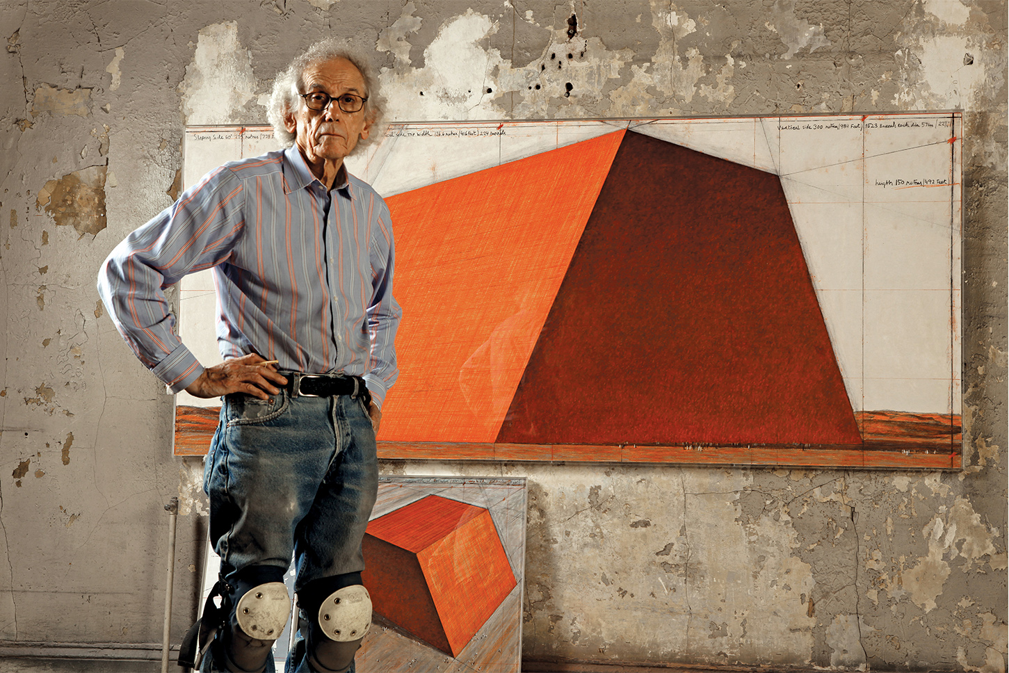 Christo in his studio with a preparatory drawing for The Mastaba, 2012, Photo: Wolfgang Volz, © 2012 Christo
